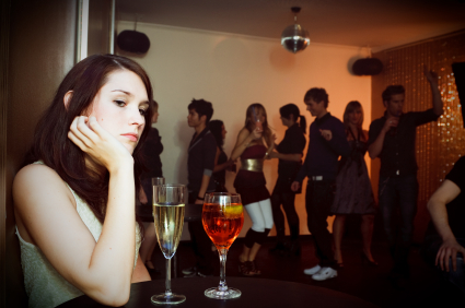 Young woman alone at club